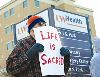 Pro-lifer protests outside the Madison Surgery Center in 2009.