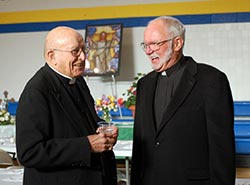 Bishop Bullock and Father Coyle laugh