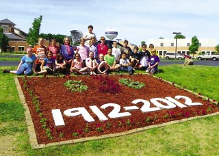 Fourth and fifth grade students at St. Joseph School, Fort Atkinson, display their garden for the centennial.