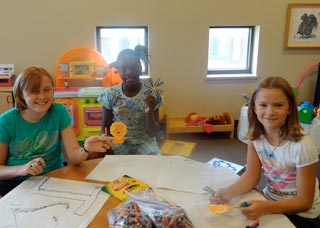 Youth play during a Story Time at the Madison Catholic Multicultural Center. (Contributed photo)