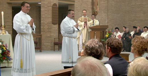 Two transitional deacons, Garrett Kau, left, and Vincent Brewer, were ordained by Bishop Robert C. Morlino for the Diocese of Madison on May 25 in the chapel of the Bishop O'Connor Center in Madison. To see more pictures go to www.madisoncatholicherald.smugmug.com (Catholic Herald photos/Joe Ptak)