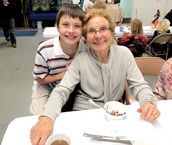 Pictured is Vincent Evans enjoying lunch with his grandmother at All Saints School in Berlin.