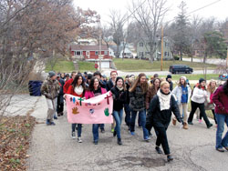 """About 70 eighth-graders from the four Catholic grade schools in Janesville walk through various neighborhoods on November 20 as part of a """"Walk for Life"""" service project."""