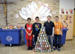 Pictured are St. Dennis fifth-graders from the class that donated the most items to St. Vincent de Paul in a food recent food drive.
