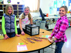 """Students at All Saints Catholic School in Berlin are selling """"Threads of Hope"""" bracelets, made by women in the Philippines. Half of the money raised will be sent back to help women and their families in the Philippines, which is still recovering from the aftermath of Typhoon Haiyan; the other half will support children and families in need in the Berlin area."""