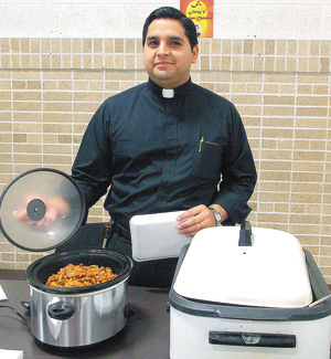 Fr. Jerry Zhanay presents chicken dish