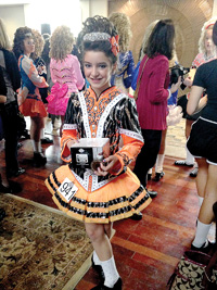 Seventh-grader Bridget Thompson, from St. Dennis School in Madison, is seen in one of her Irish dancing outfits.